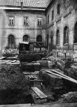 Excavation in the paradise garden of the monastery, view from the north, in the background a modern water tank. Author unknown, 1961. © ARÚ Praha, inv. No. FT000064501.