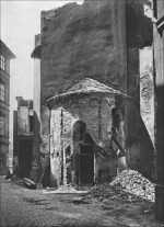 The Eastern apse of the Romanesque Church of St. John the Baptist in Na Zábradlí street shortly before demolition in 1896. View from Anenské Square (Podliska 2002).
